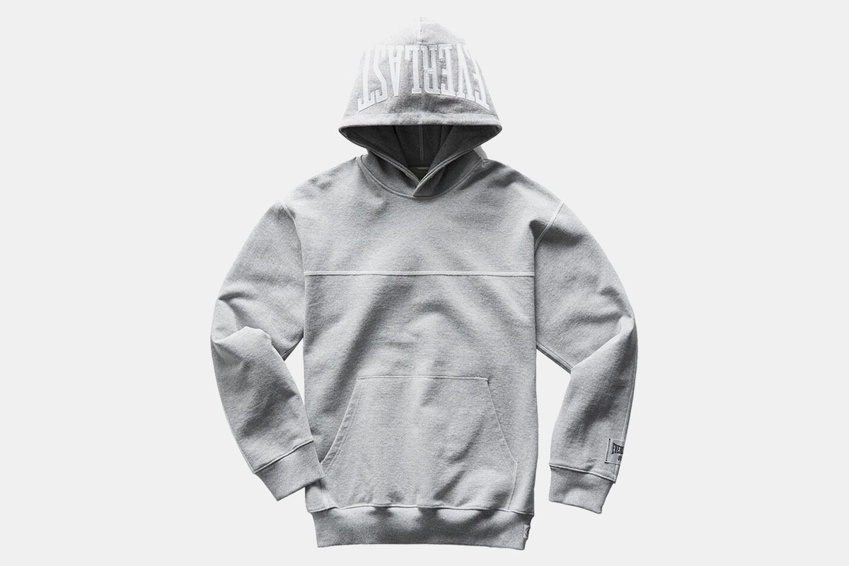 A hoodie from Reigning Champ and Everlast in grey on a white background