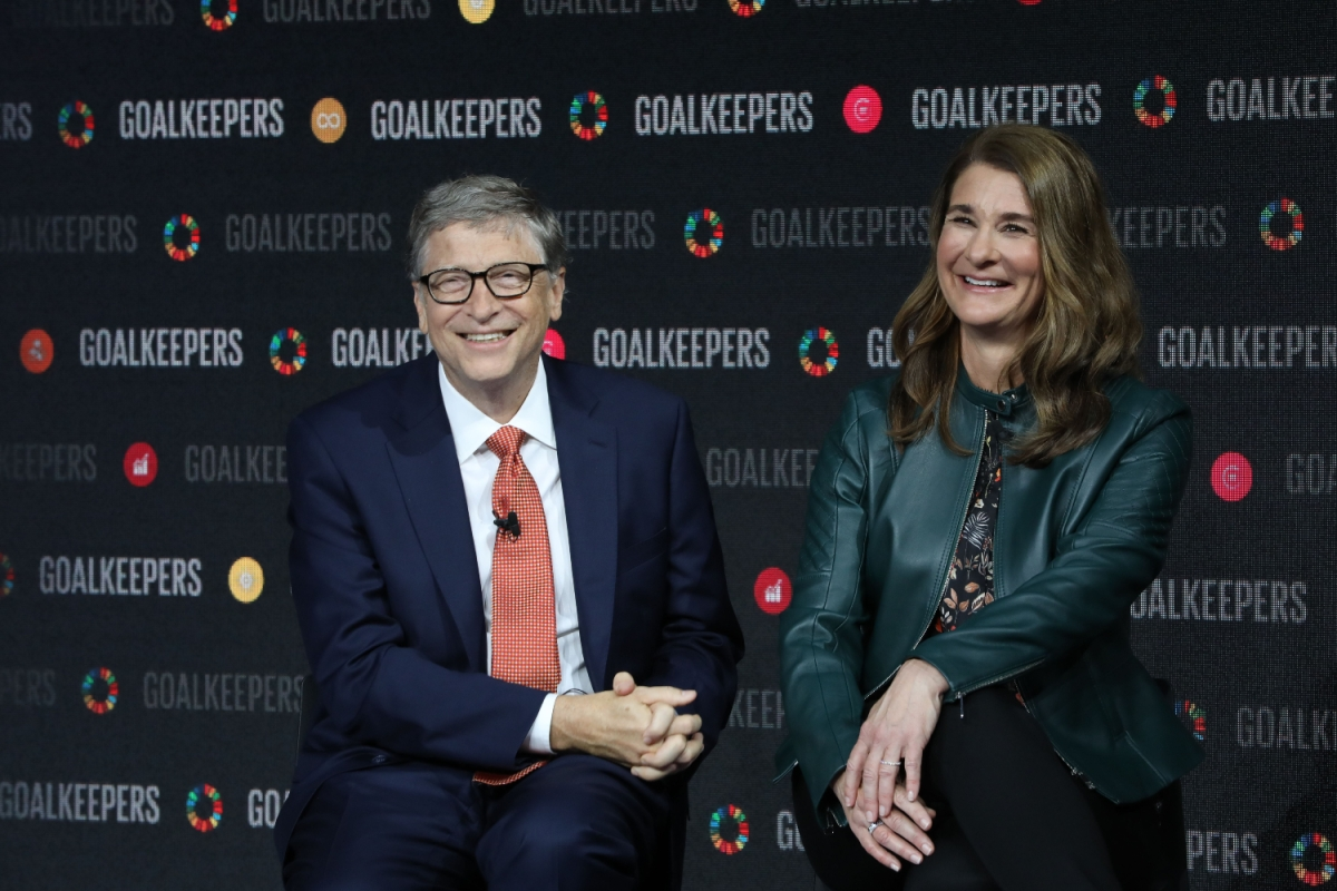 Bill and Melinda Gates sit smiling side-by-side during the Goalkeepers event at the Lincoln Center