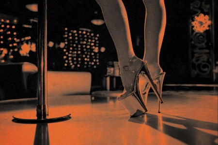 woman wearing platform heels stands near stripper pole