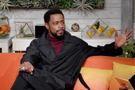 """Lakeith Stanfield sits on a couch at BuzzFeed's """"AM To DM"""" show"""