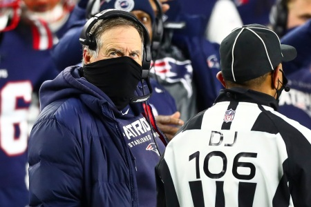 FOXBOROUGH, MA - DECEMBER 28: Head coach Bill Belichick of the New England Patriots talks to an official during a game against the Buffalo Bills at Gillette Stadium on December 28, 2020 in Foxborough, Massachusetts.