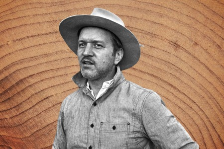 Best Made Co. founder Peter Buchanan-Smith in black and white on a wood grain background