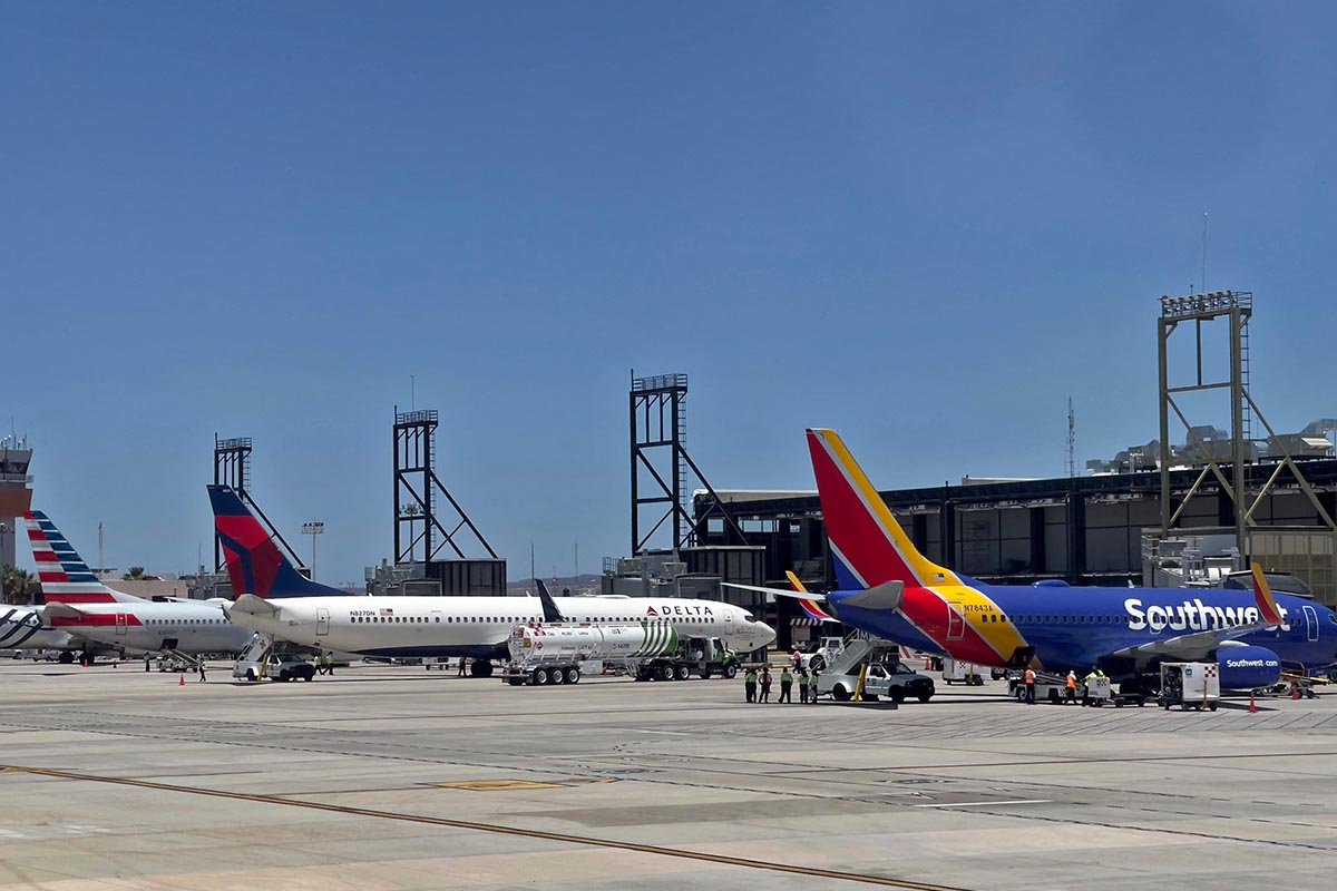 Southwest airlines (C) and Delta sirlines (R) aircrafts are seen at the San Jose del Cabo International Airport (SJD) in Baja California state, Mexico, on April 29, 2021