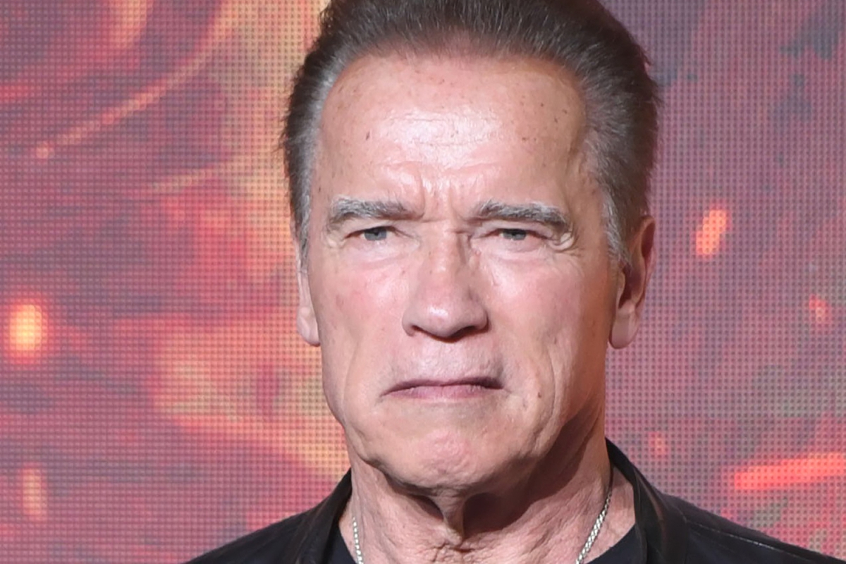 Closeup of Arnold Schwarzenegger's face looking disgruntled