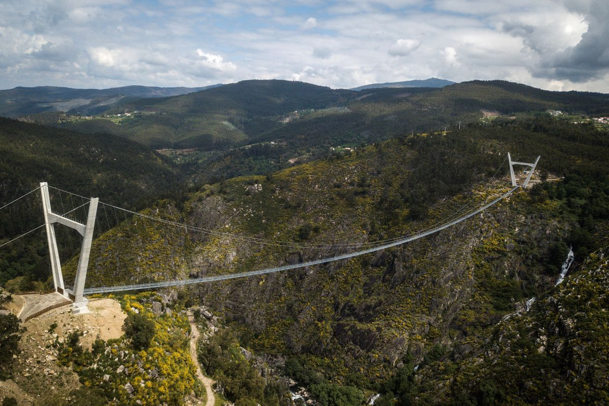 An aerial view shows the 516 Arouca Bridge, the world's longest pedestrian suspension bridge with a length of 516 meters and a height of 175 meters, in Arouca in northern Portugal on April 29, 2021.