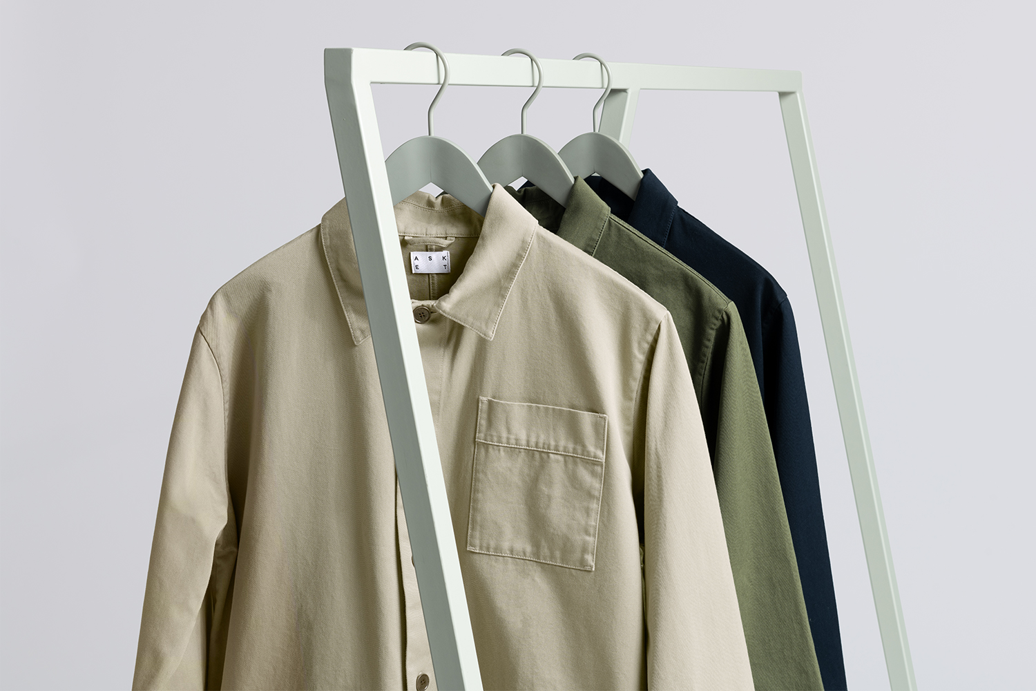A clothing rack holding overshirts from menswear brand Asket