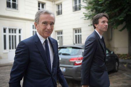 LVMH CEO Bernard Arnault and his son Antoine Arnault arrive at Paris' Archbishop residence on September 24, 2019.
