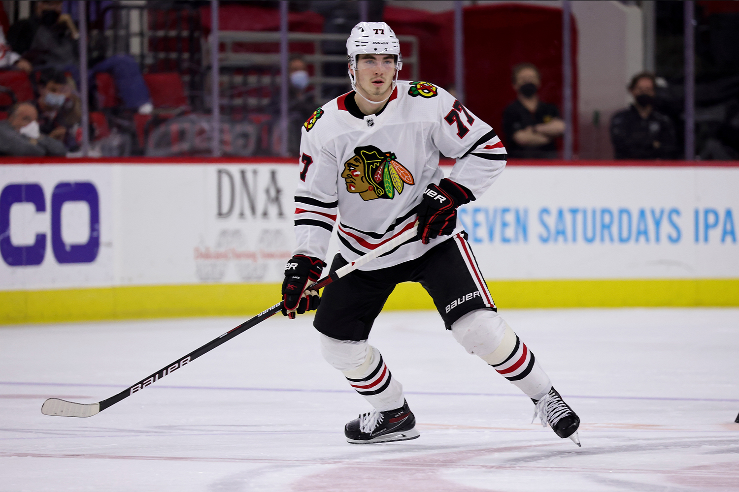 Kirby Dach #77 of the Chicago Blackhawks skates for position on the ice during an NHL game against the Carolina Hurricanes on May 3, 2021