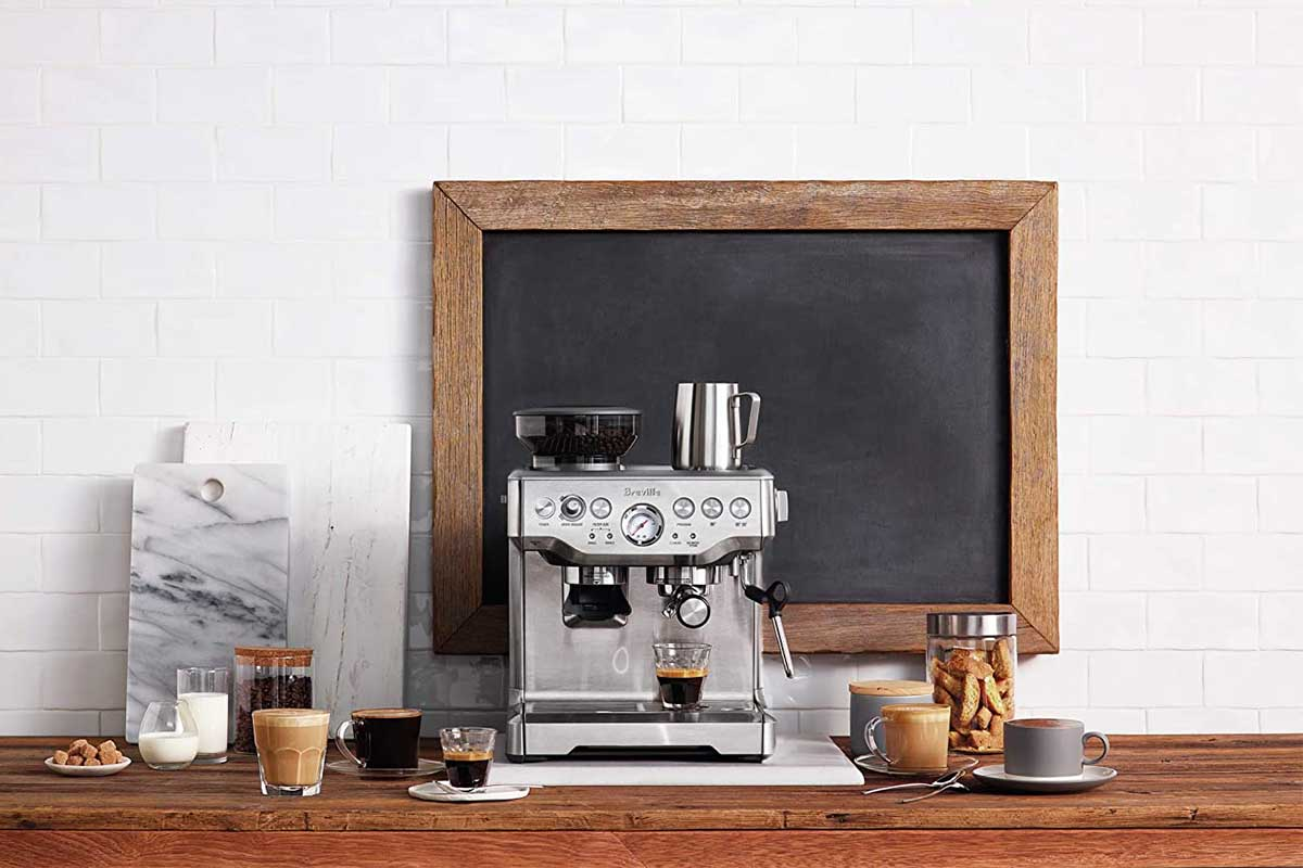 The Breville BES870BSXL The Barista Express Coffee Machine on a counter; Amazon has this model on sale for $100 off