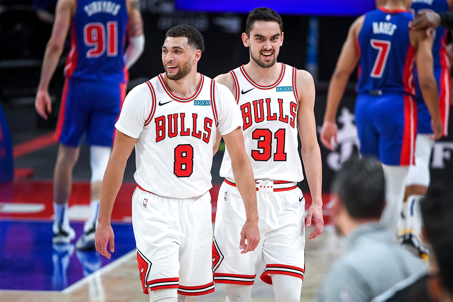 Zach LaVine #8 and Tomas Satoransky #31 of the Chicago Bulls smile during the fourth quarter of the NBA game against the Detroit Pistons