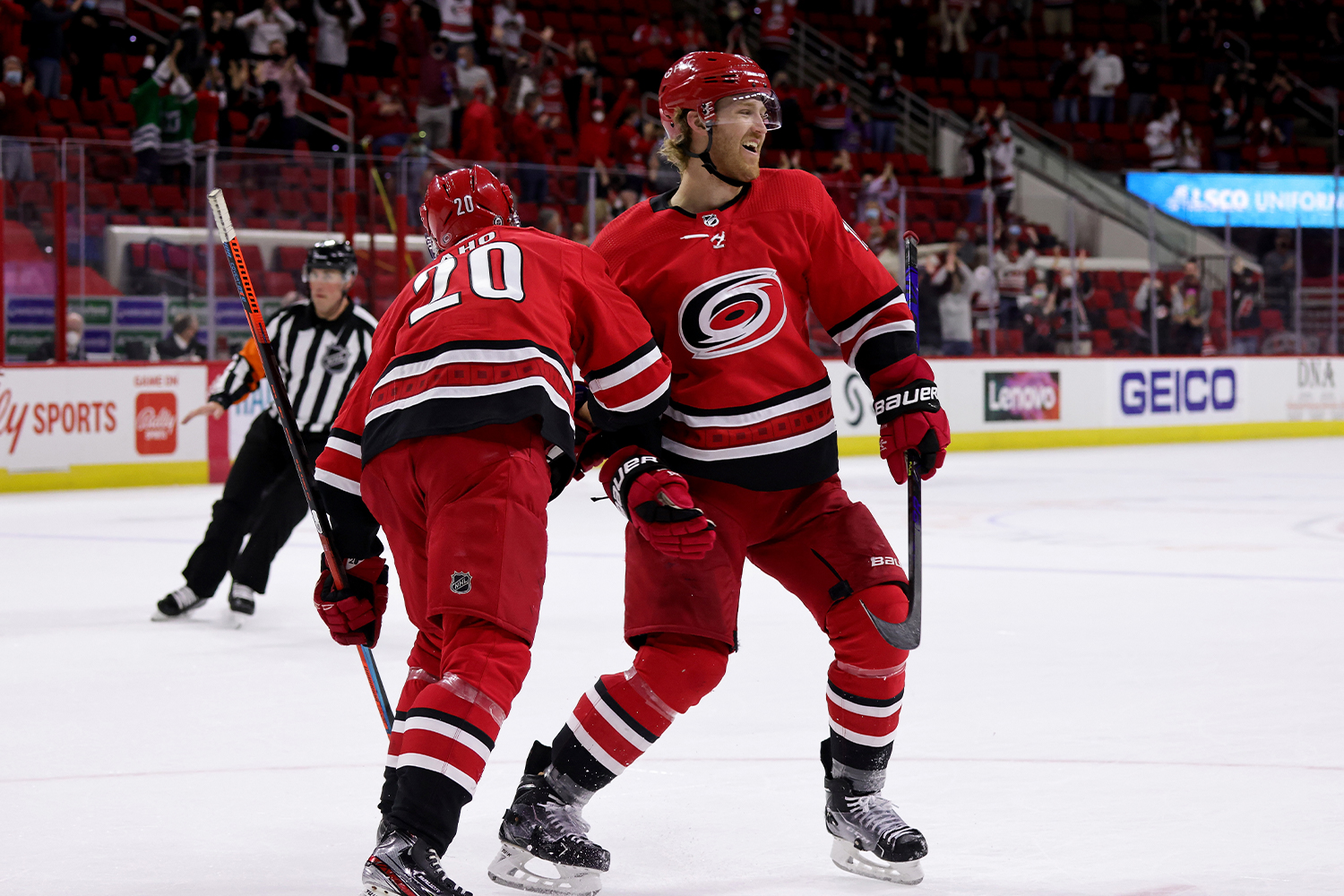 Dougie Hamilton #19 of the Carolina Hurricanes scores a goal in overtime and celebrates with teammate Sebastian Aho #20 during an NHL game against the Columbus Blue Jackets on May 1, 2021