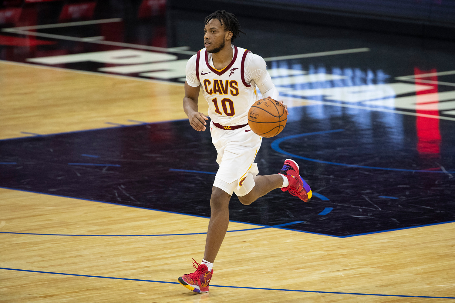 Darius Garland #10 of the Cleveland Cavaliers dribbles the ball against the Philadelphia 76ers