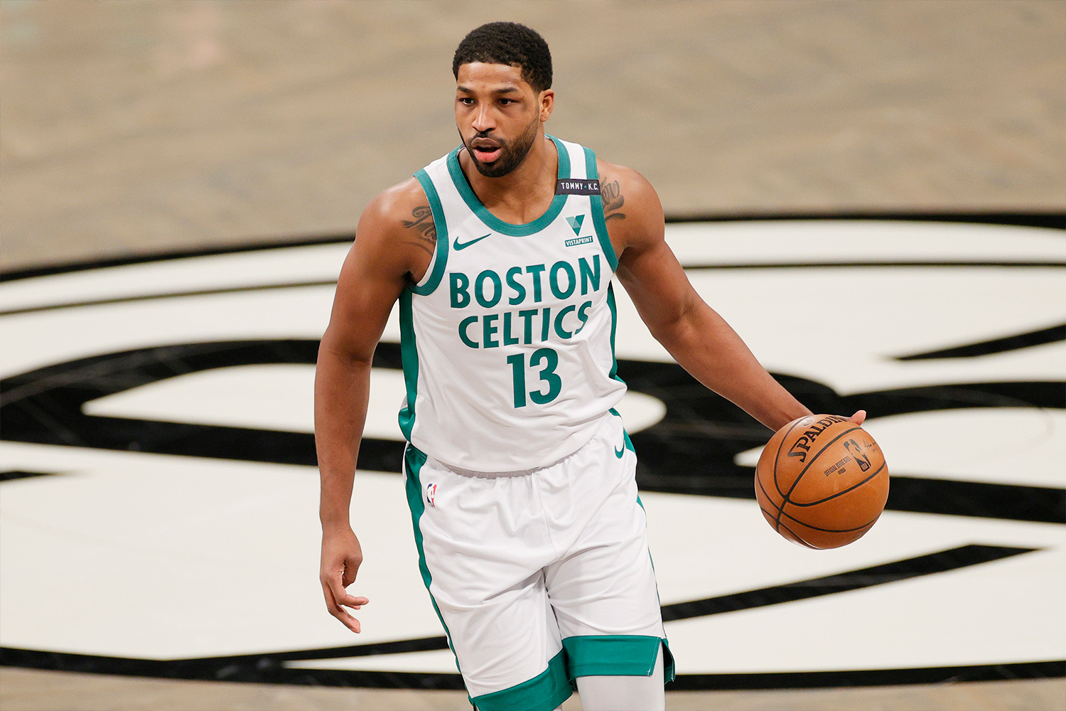 Tristan Thompson #13 of the Boston Celtics dribbles during the first half against the Brooklyn Nets