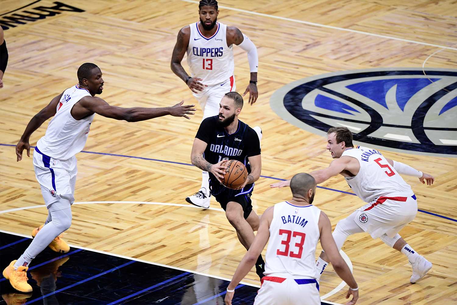 Evan Fournier #10 of the Orlando Magic drives to the net between multiple LA Clippers