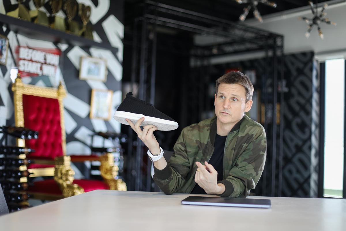 Rob Dyrdek holds a Lusso Cloud slipper at Dyrdek Machine headquarters