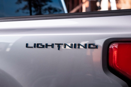 The word Lightning on the side of Ford's new electric F-150 pickup truck