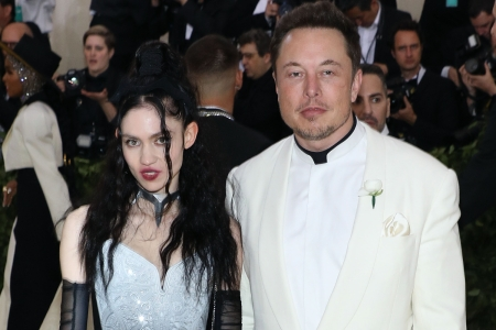 """Grimes and Elon Musk attend """"Heavenly Bodies: Fashion & the Catholic Imagination"""", the 2018 Costume Institute Benefit at Metropolitan Museum of Art on May 7, 2018 in New York City"""