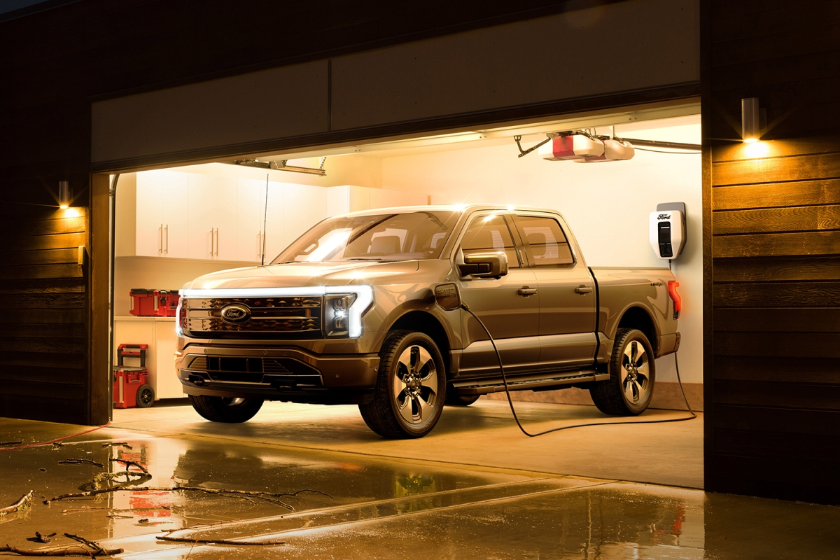 Ford F-150 Lightning electric pickup truck charging in a garage