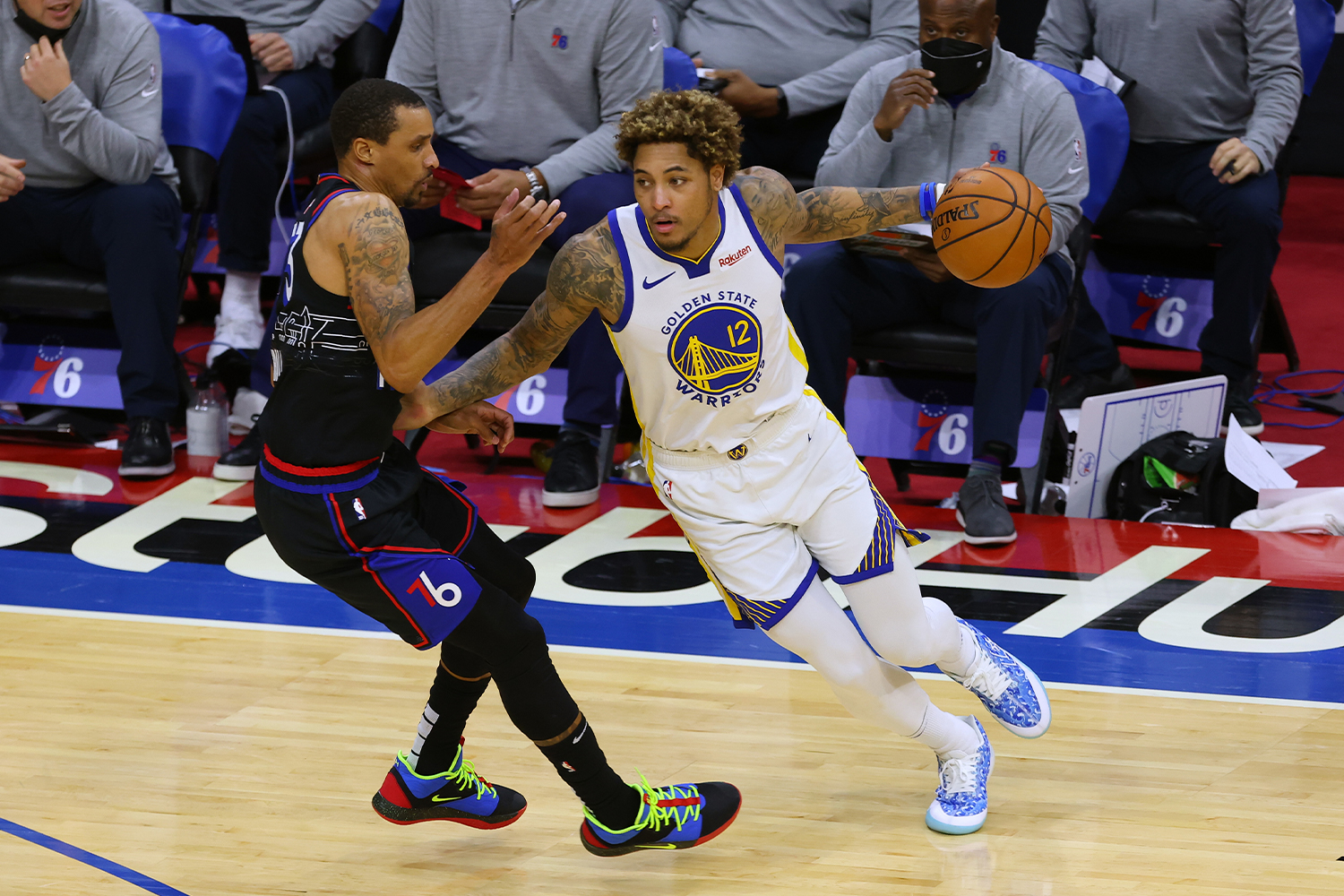Kelly Oubre Jr. #12 of the Golden State Warriors in action against George Hill #33 the Philadelphia 76ers