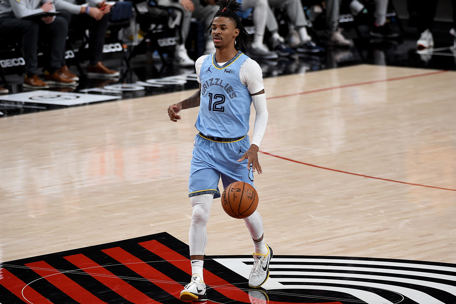 Ja Morant #12 of the Memphis Grizzlies brings the ball up the court during the first half of the game against the Portland Trail Blazers