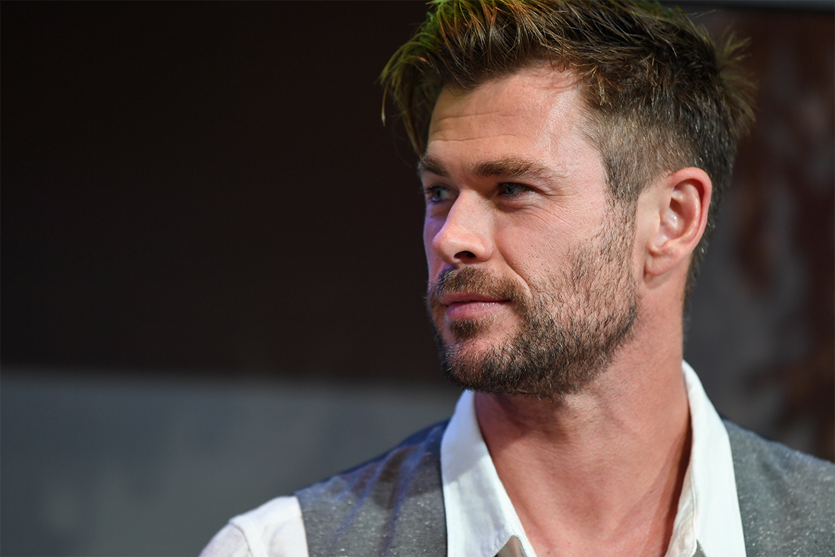 """""""Thor"""" actor Chris Hemsworth looking to his right"""