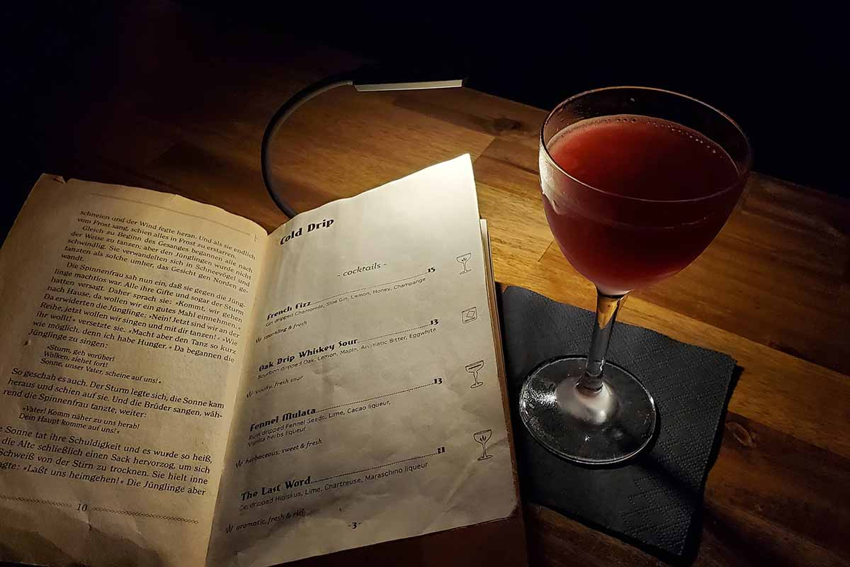 A drink menu and cocktail from Hamburg's Drip Bar, where they infuse cocktails via cold brew drippers
