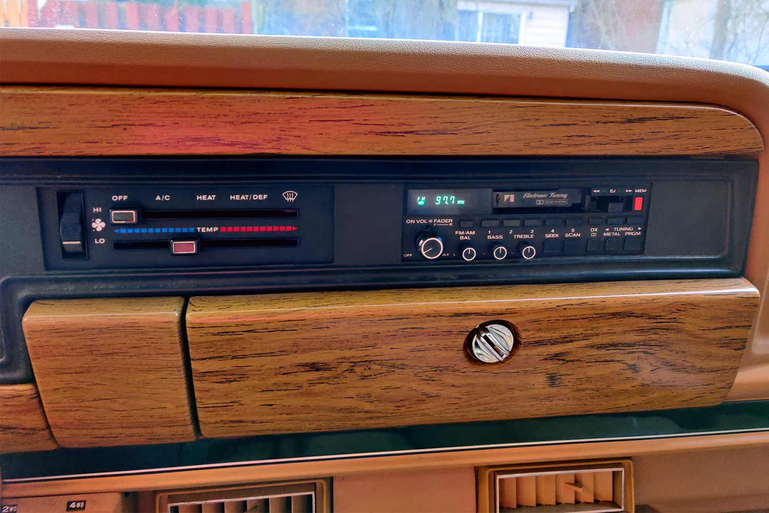 The period-correct tape deck of a 1987 Jeep Grand Wagoneer