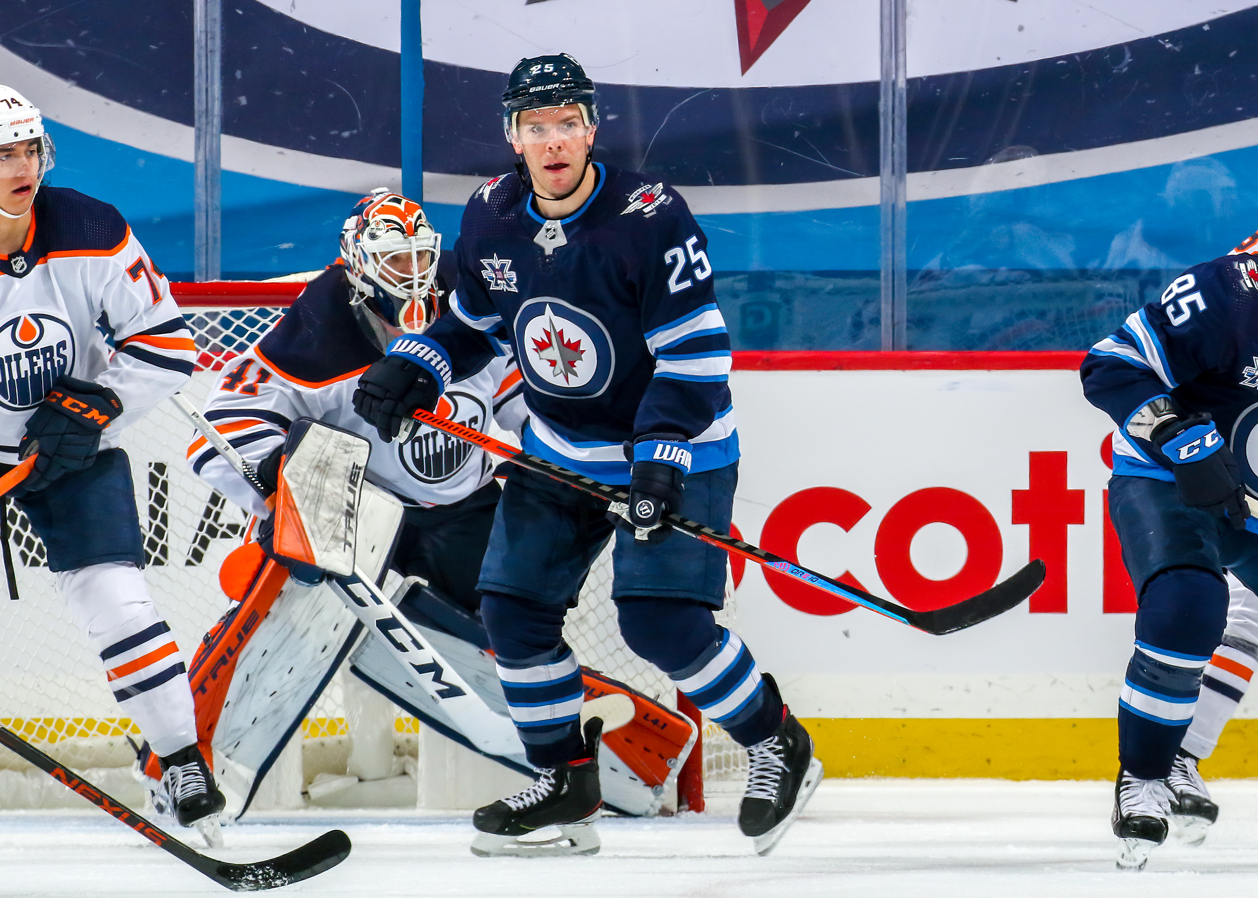 Paul Stastny #25 of the Winnipeg Jets keeps an eye on the play during third period action against the Edmonton Oilers at Bell MTS Place on April 17, 2021