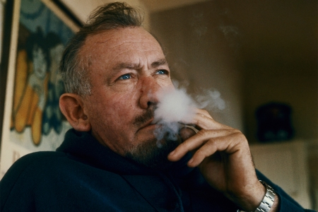 Author John Steinbeck smoking at his house in Sag Harbor, Long Island in 1962