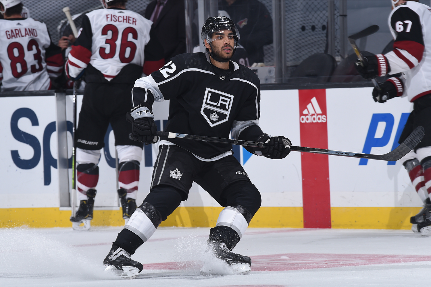 Andreas Athanasiou #22 of the Los Angeles Kings skates on the ice during the third period against the Arizona Coyotes at STAPLES Center on April 7, 2021