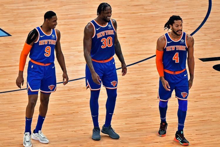 RJ Barrett, Julius Randle and Derrick Rose of the New York Knicks on the court