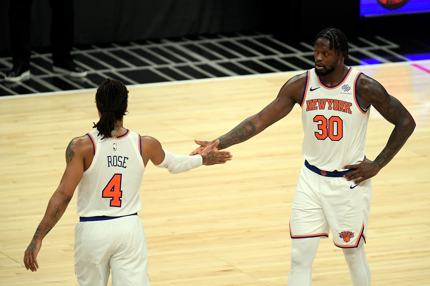 Julius Randle #30 of the New York Knicks and Derrick Rose #4 celebrate after defeating the Los Angeles Clippers