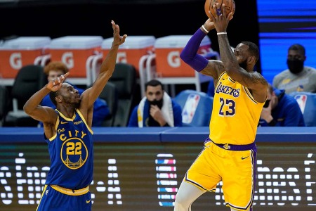 LeBron James #23 of the Los Angeles Lakers shoots over Andrew Wiggins #22 of the Golden State Warriors during the second half of an NBA basketball game at Chase Center on March 15, 2021 in San Francisco, California