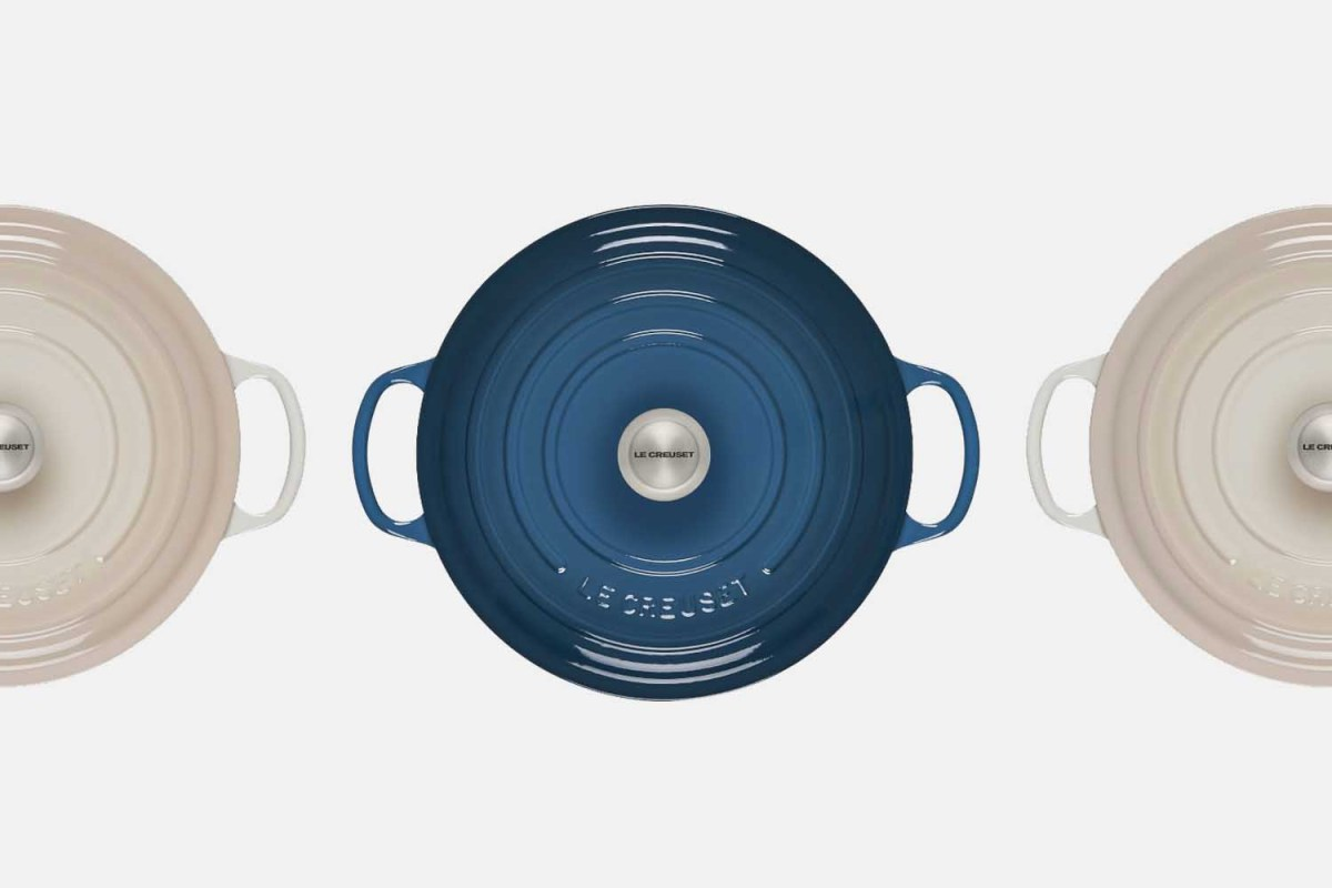 Le Creuset's round wide dutch oven shot from overhead in blue and white