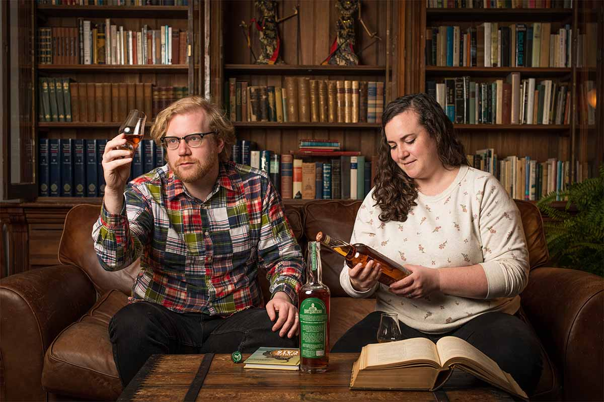 Lost Lantern founders Adam Polonski and Nora Ganley-Roper at home drinking whiskey