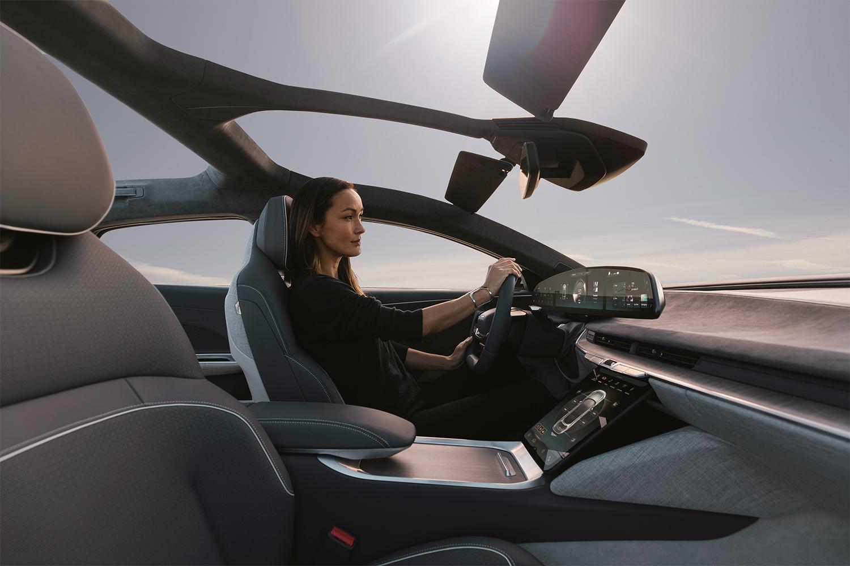 A woman driving the electric Lucid Air sedan