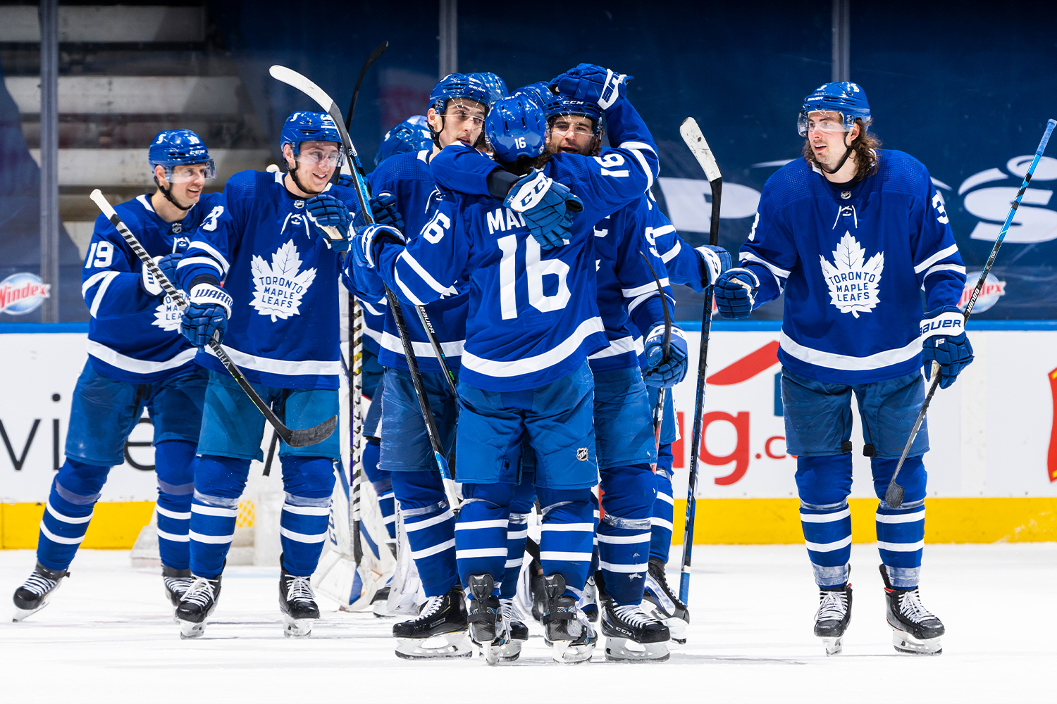 Mitchell Marner #16 and John Tavares #91 of the Toronto Maple Leafs hug after their team defeated the Vancouver Canucks at the Scotiabank Arena on April 29, 2021