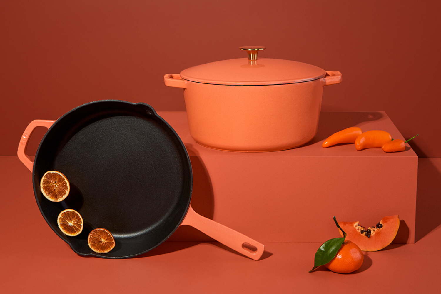 A Milo cast iron skillet and enameled Dutch oven in the color terracotta