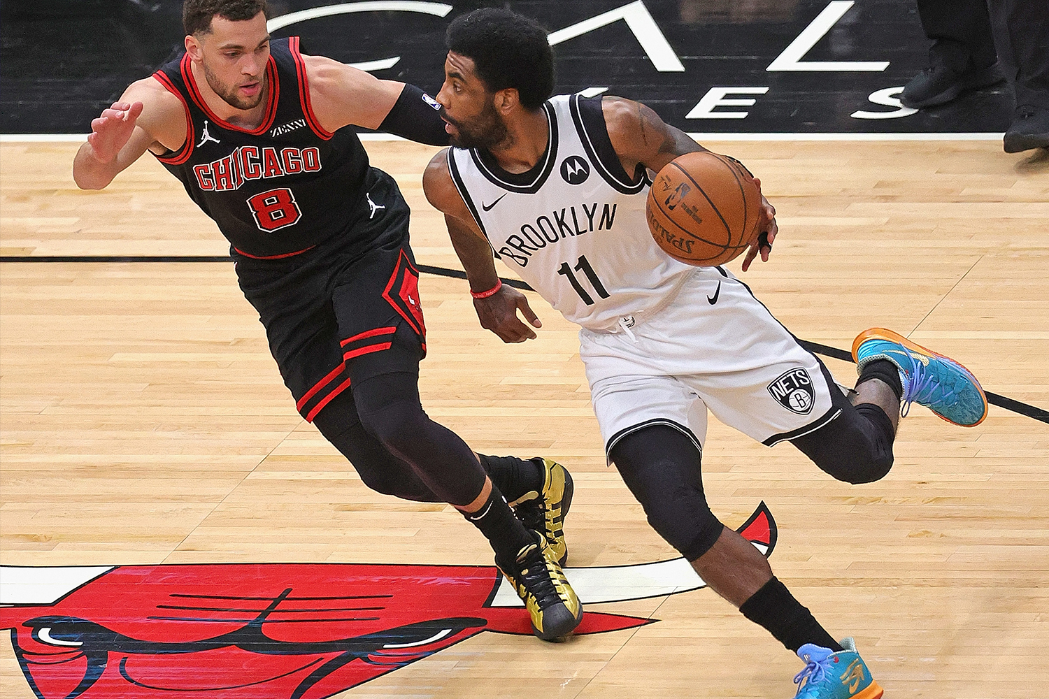 Kyrie Irving #11 of the Brooklyn Nets drives against Zach LaVine #8 of the Chicago Bulls