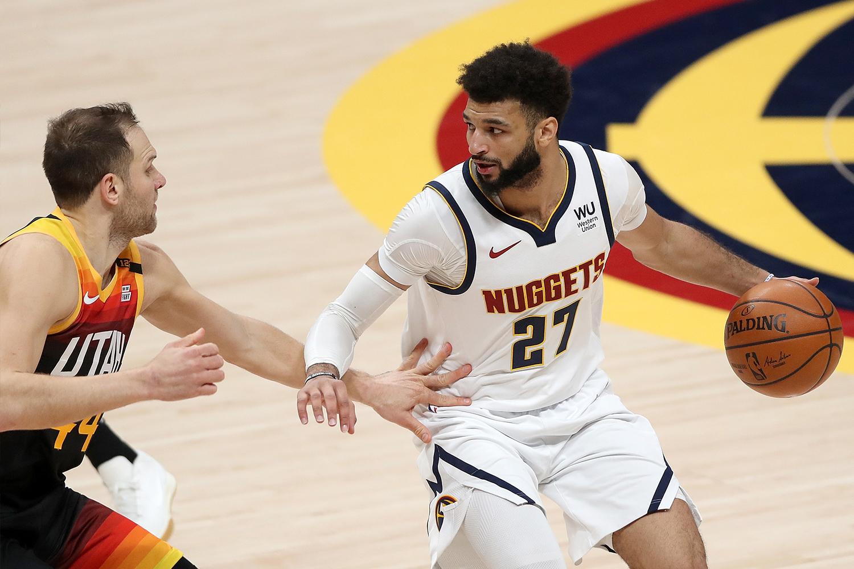 Jamal Murray #27 of the Denver Nuggets drives against Bojan Bogdanovic #44 of the Utah Jazz