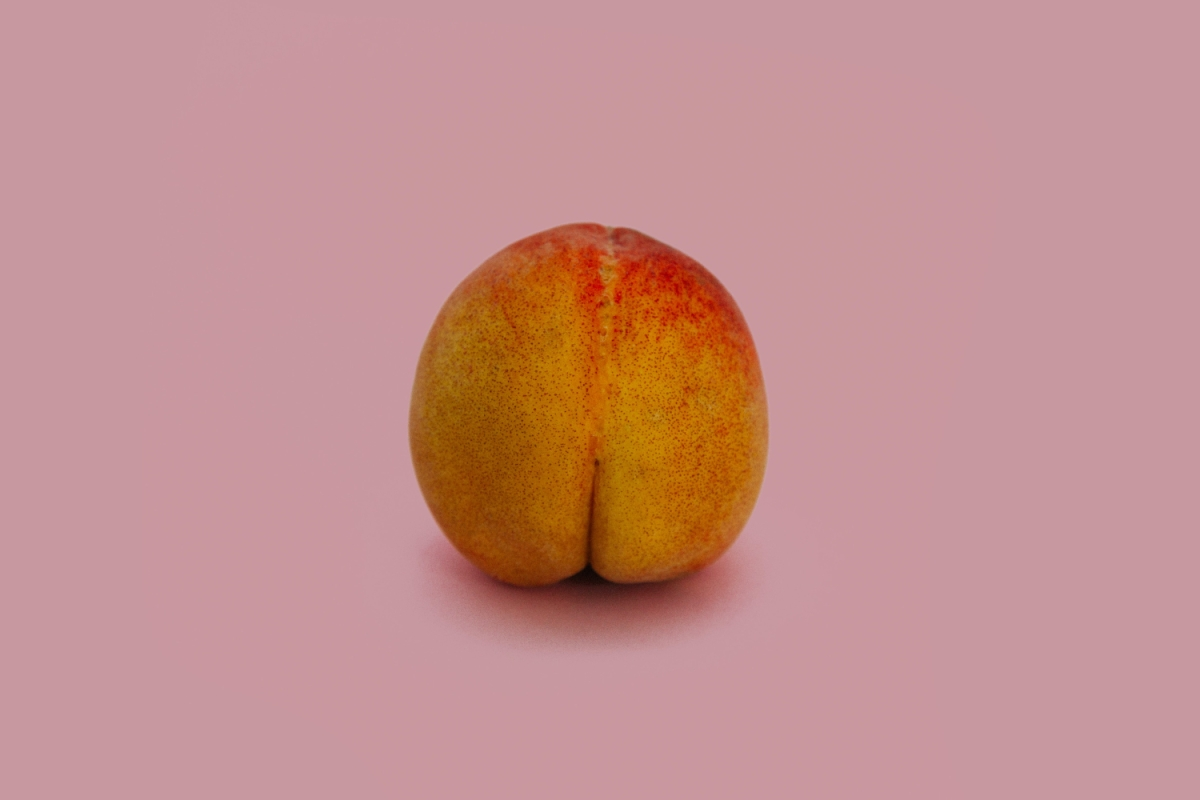 Peach on dusty pink background.