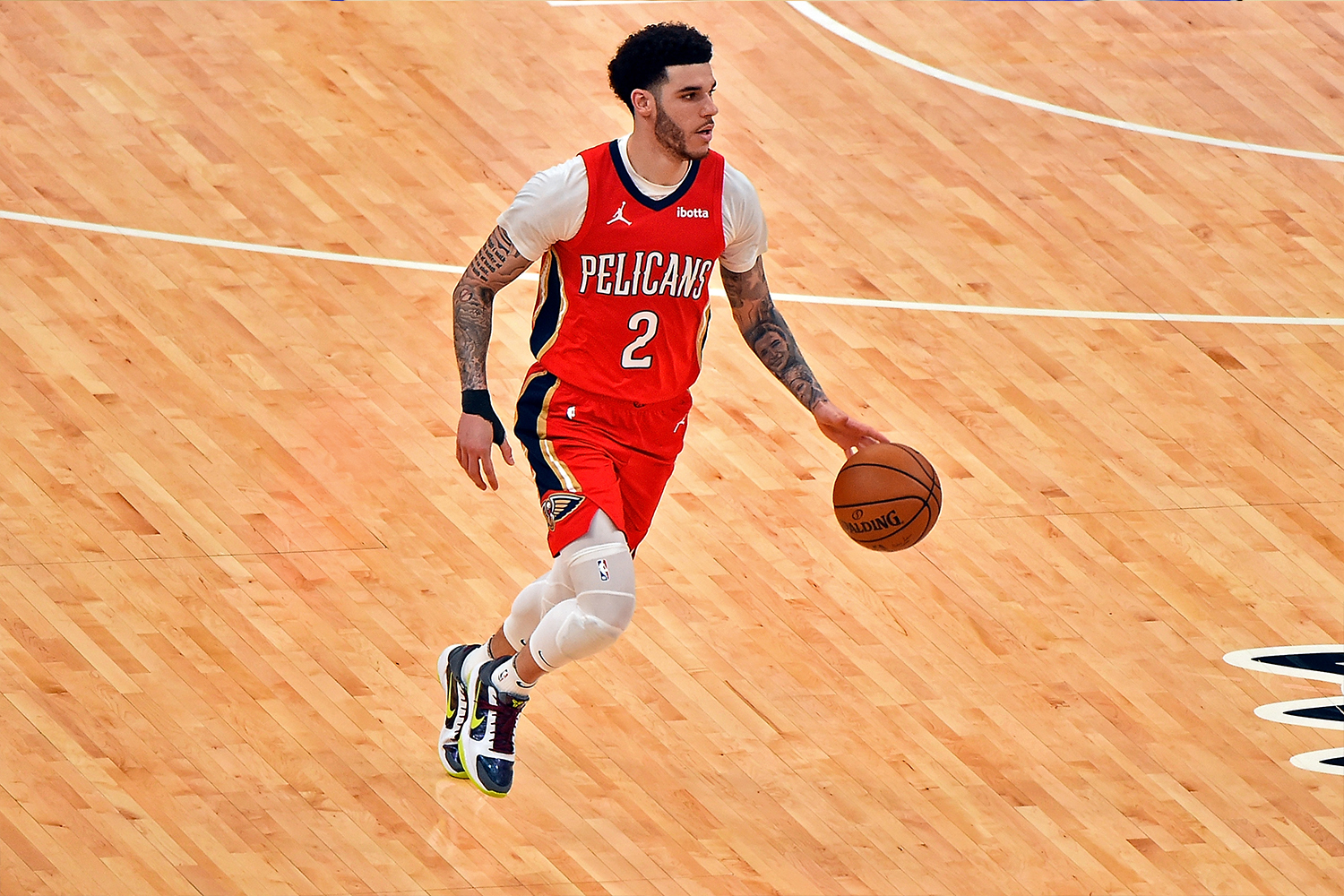 Lonzo Ball #2 of the New Orleans Pelicans brings the ball up court during the second half against the Memphis Grizzlies