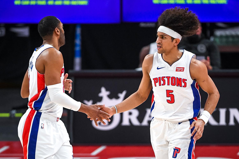 Wayne Ellington #8 of the Detroit Pistons high fives Frank Jackson #5 of the Detroit Pistons during the fourth quarter of the NBA game against the Memphis Grizzlies