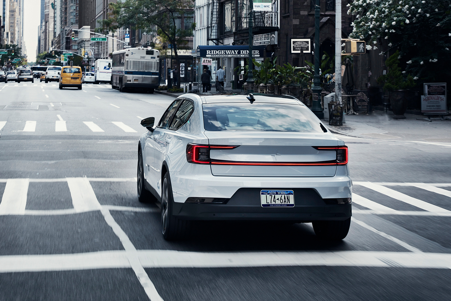 The 2021 Polestar 2 driving down the streets of New York City