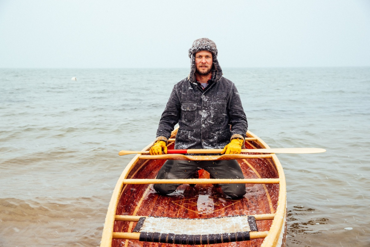 Wooden boatbuilder Trent Preszler paddles a canoe he made in the cold winter waters of Great Peconic Bay in Mattituck on  Tuesday, Jan. 31, 2017. The canoe is made of aromatic red cedar, black walnut and Basswood, with custom cast bronze cutwater made by Greenport based metalsmith Kristian Iglesias, KAI Design.