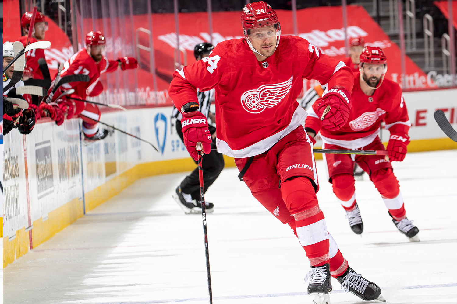 Richard Panik #24 of the Detroit Red Wings skates after a loose puck against the Chicago Blackhawks during an NHL game at Little Caesars Arena on April 17, 2021