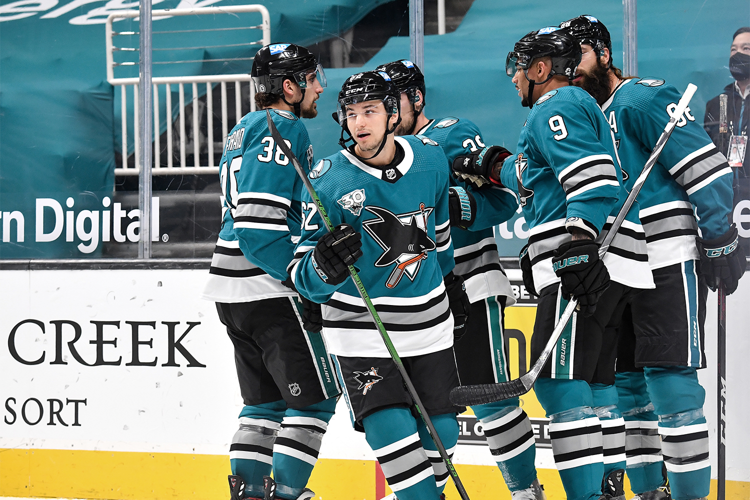 Kevin Labanc #62, Brent Burns #88, Logan Couture #39, Mario Ferraro #38 and Evander Kane #9 of the San Jose Sharks celebrate scoring a goal against the Los Angeles Kings at SAP Center on April 9, 2021