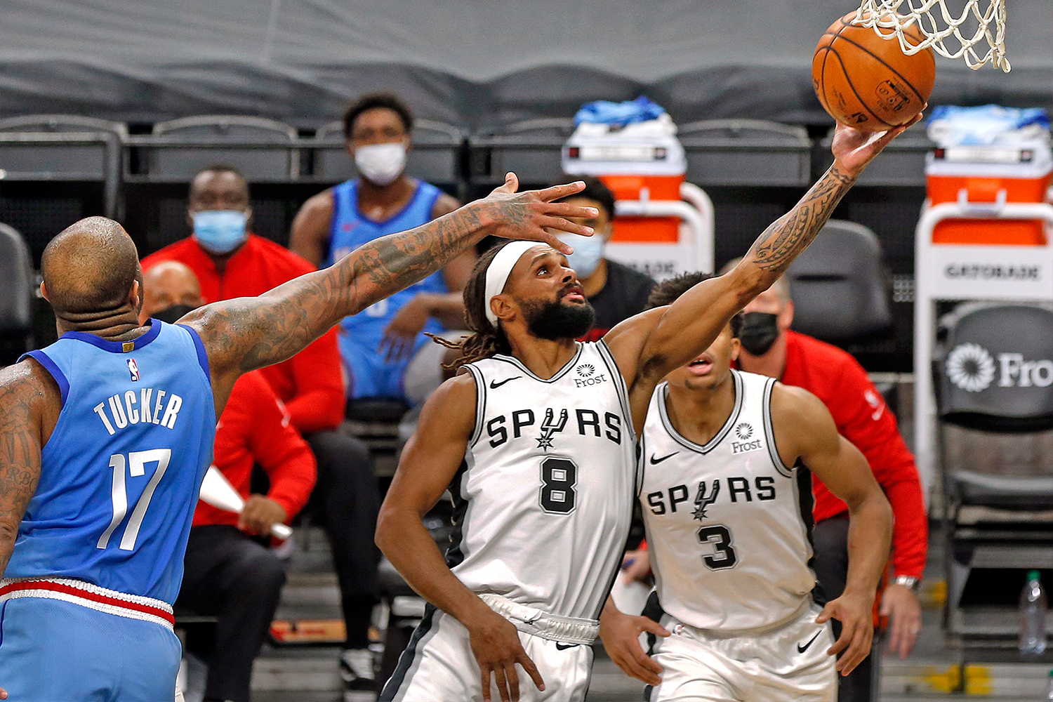 Patty Mills #8 of the San Antonio Spurs stretches to the basket past PJ Tucker #17 of the Houston Rockets
