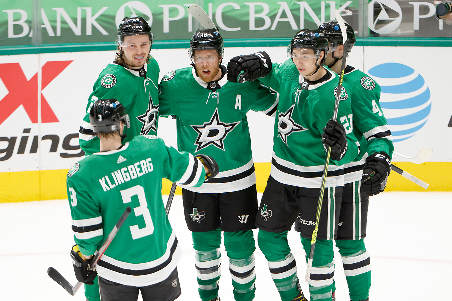 Joe Pavelski #16 of the Dallas Stars celebrates with Roope Hintz #24 of the Dallas Stars, Jason Robertson #21 of the Dallas Stars, Miro Heiskanen #4 of the Dallas Stars and John Klingberg #3 of the Dallas Stars after scoring a goal against the Tampa Bay Lightning at American Airlines Center on March 25, 2021