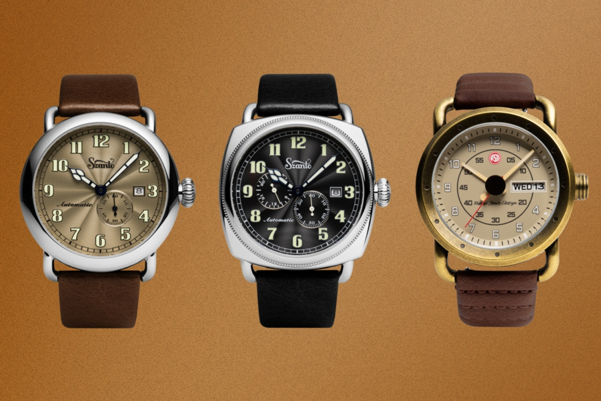 Three Szanto watches on a rust background